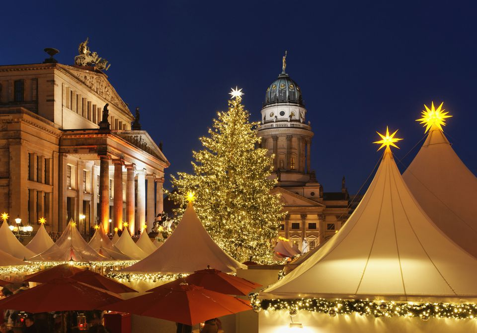 Christmas market with the Schauspielhaus and French Cathedral at night