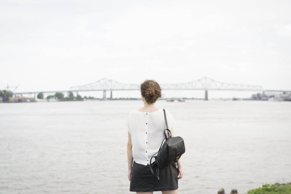 Rear view of woman looking at New orleans bridge, Mississippi river