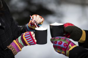 Winter Scene of Hot cocoa and girls hands in mittens