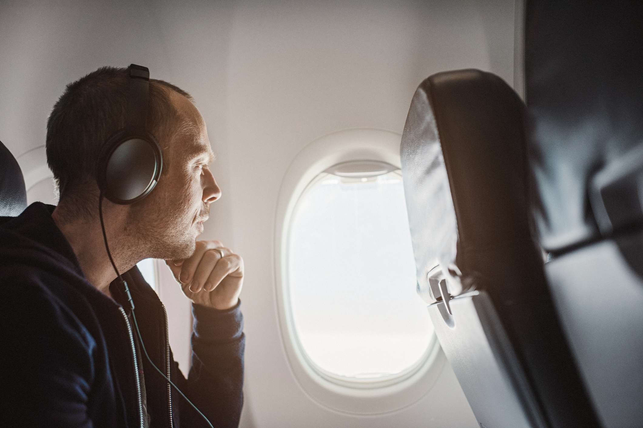 Man on plane wearing headphones
