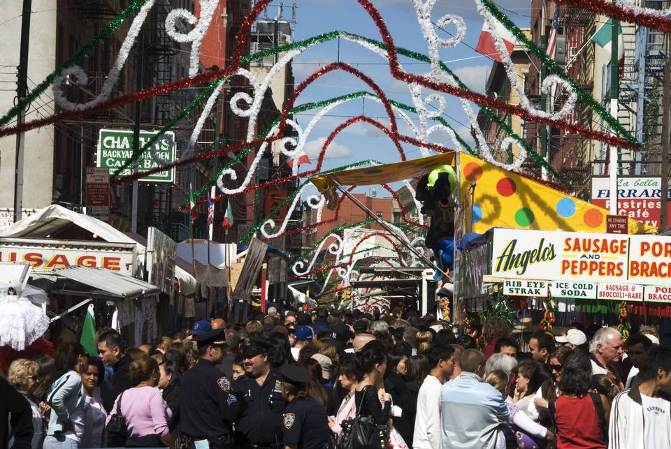 Crowds celebrating San Gennaro Festival on Mulberry Street, Little Italy.
