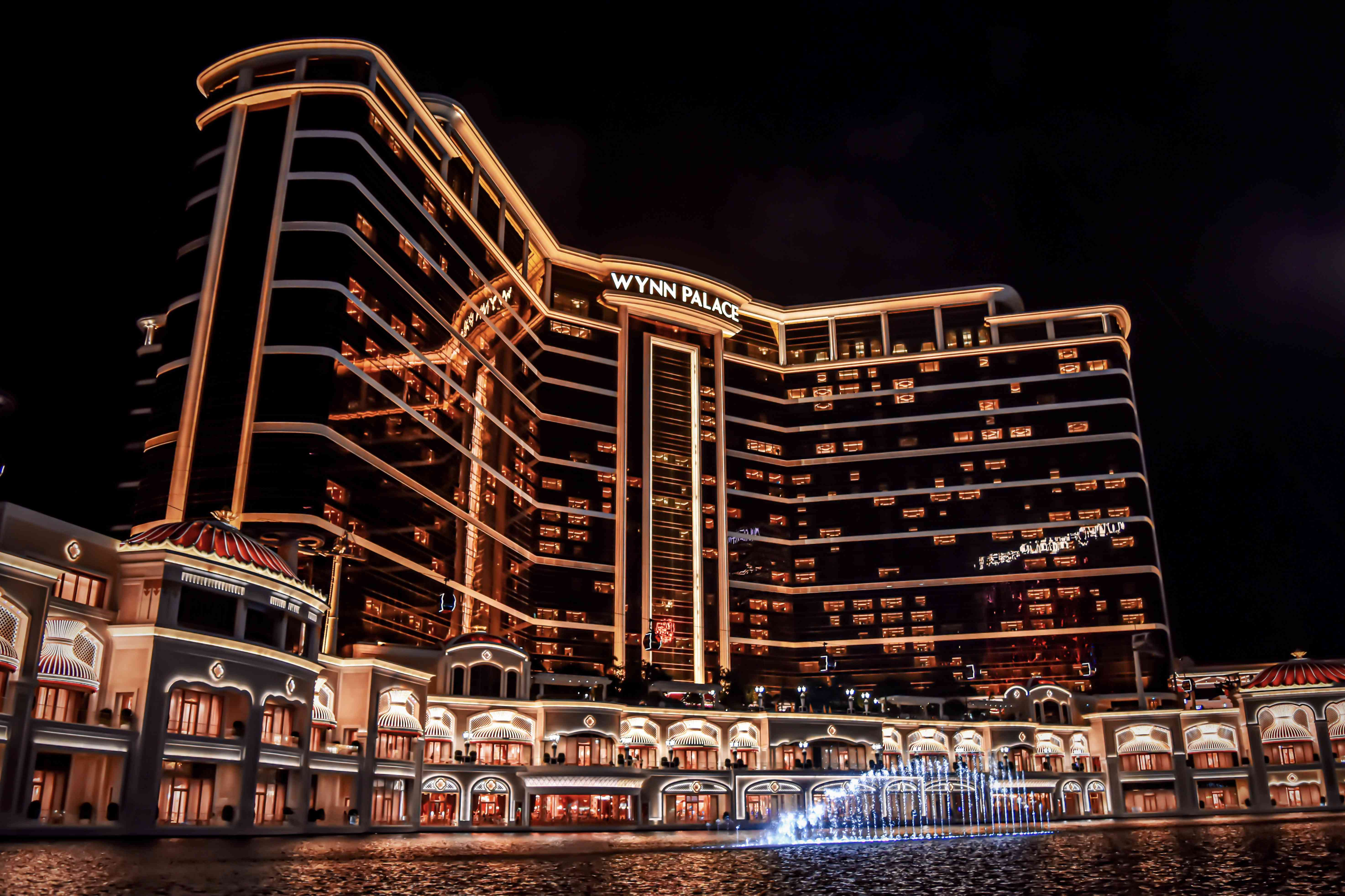 Fountain at night in front of illuminated Wynn Palace in macao