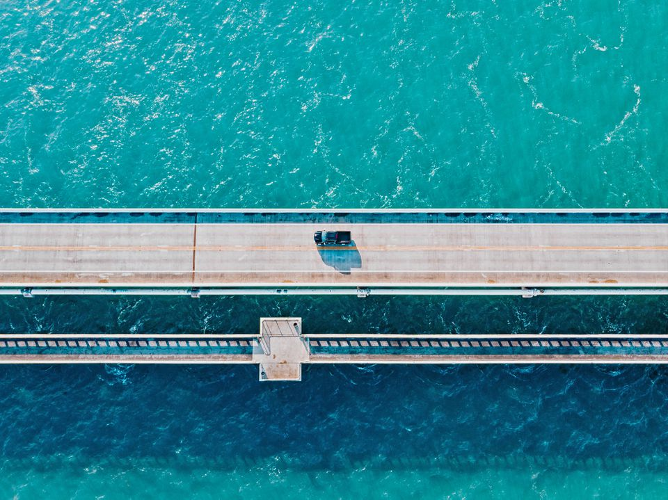 Directly above view of the Overseas Highway in Florida Keys with turquoise watercolor.