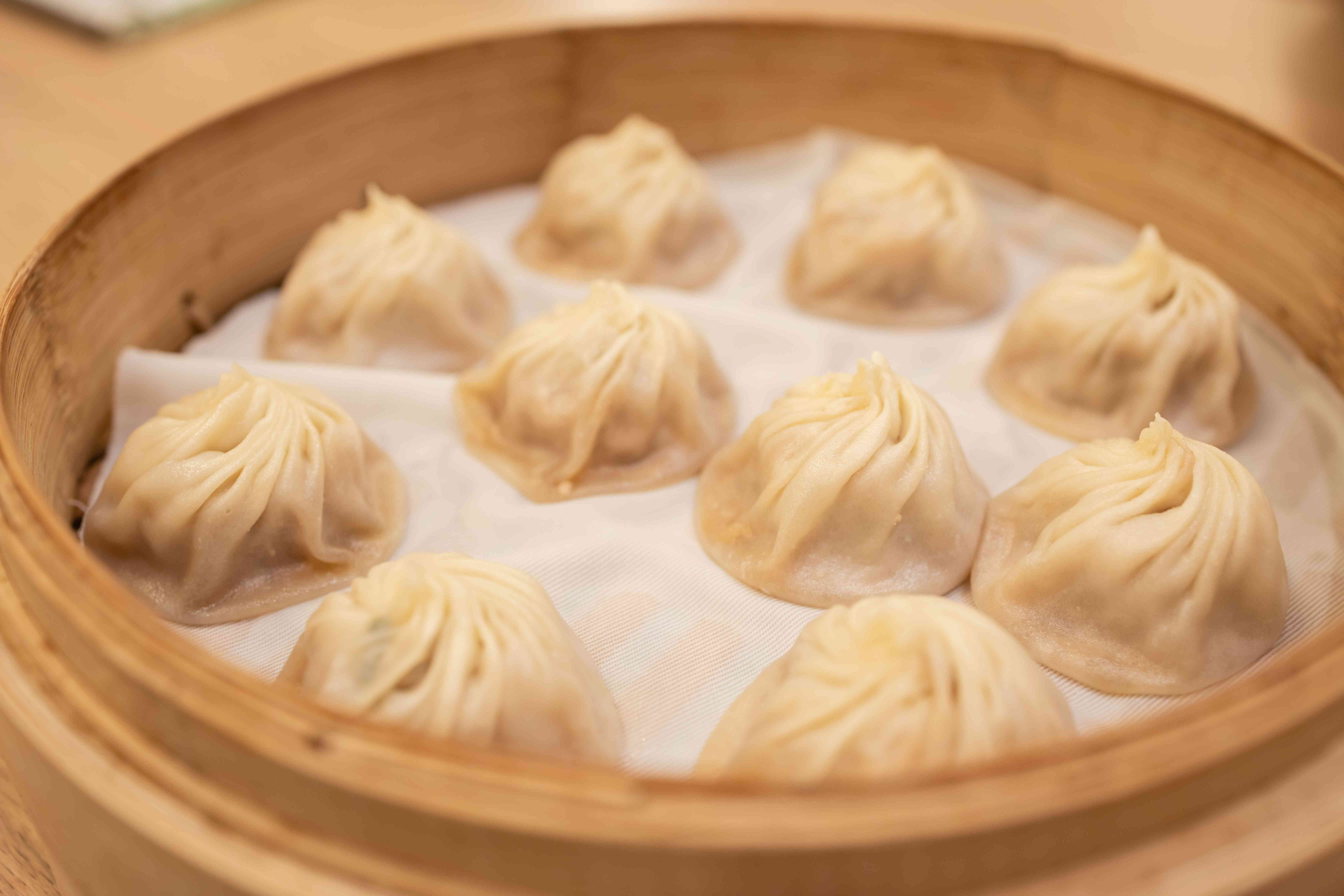 bamboo steamers with 10 soup dumplings in it
