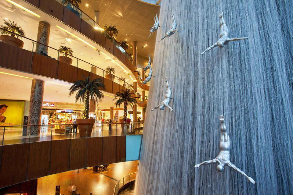 32cfdfd8d67 Waterfall and sculptures of diving men inside Dubai Mall