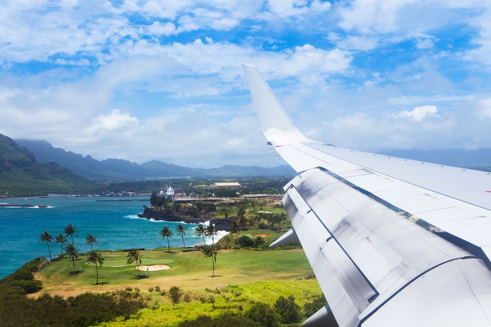 A plane flies into Lihue airport, kauai