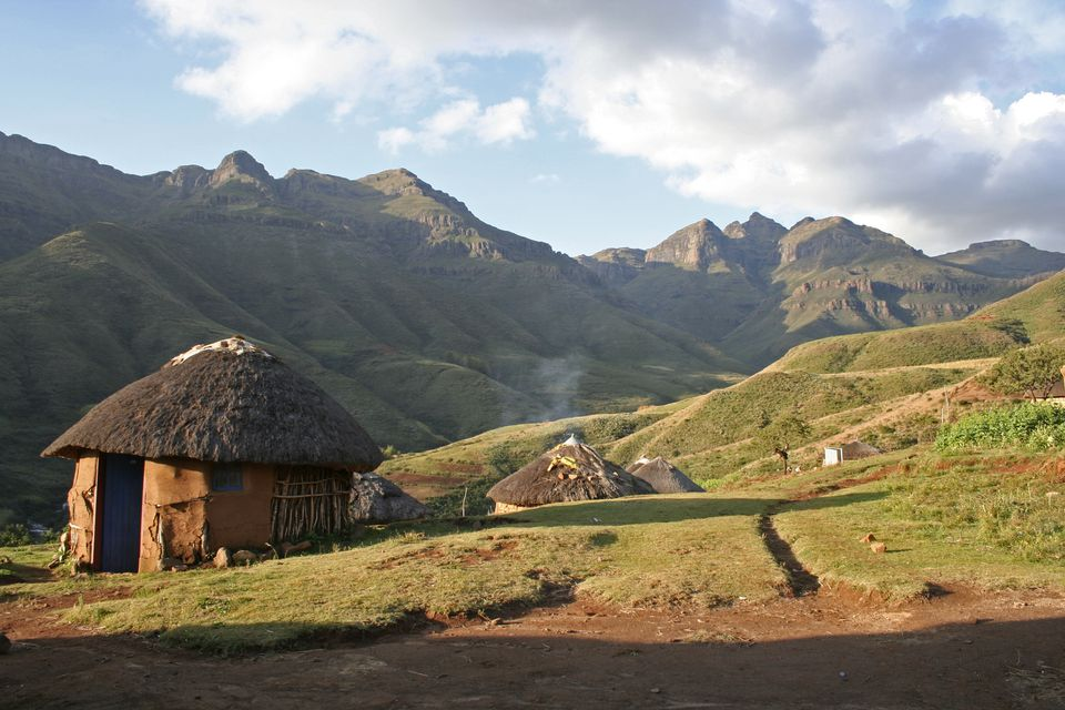 Traditional rondavel huts in the Lesotho mountains