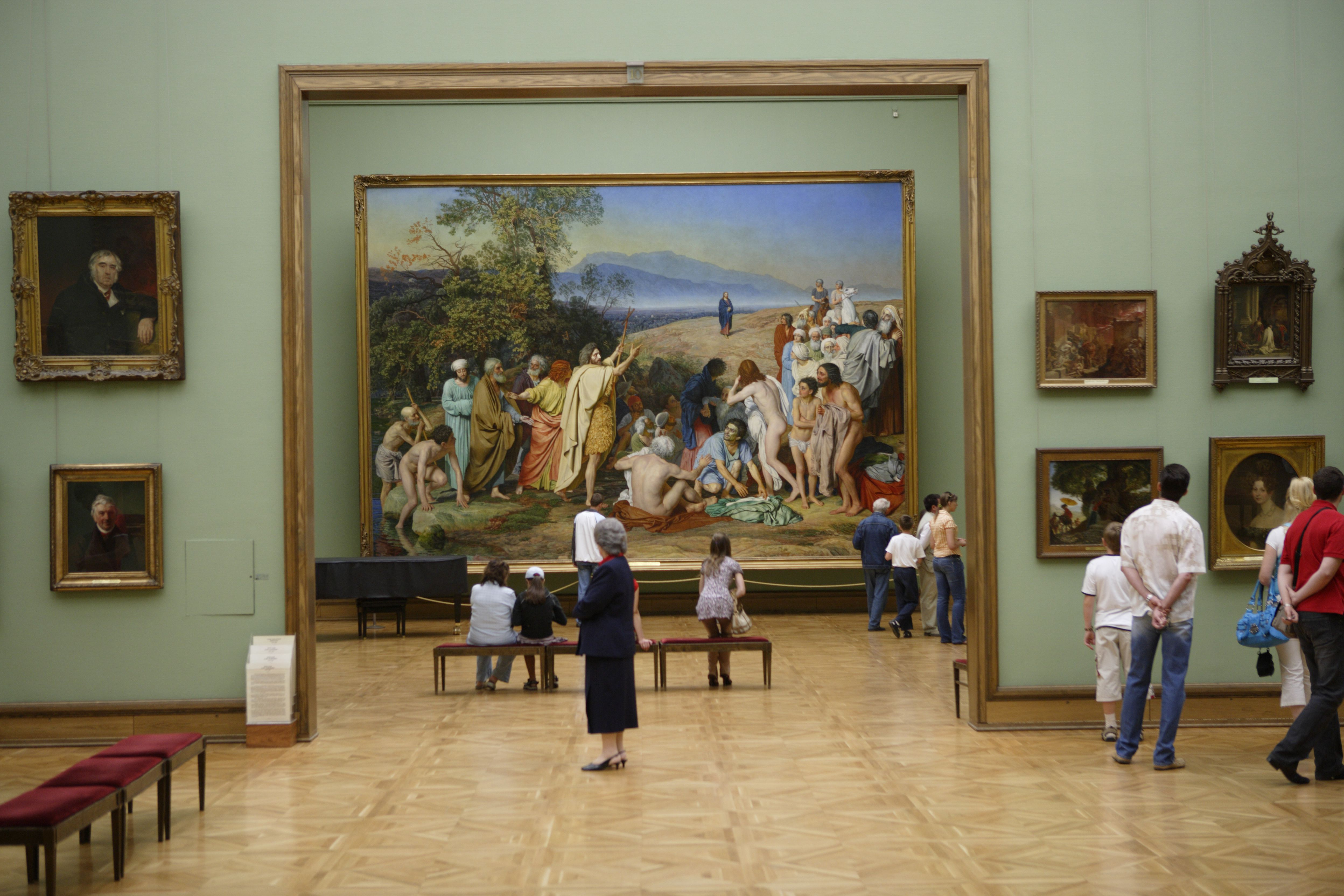 Visitors looking at paintings in Tretyakov Gallery