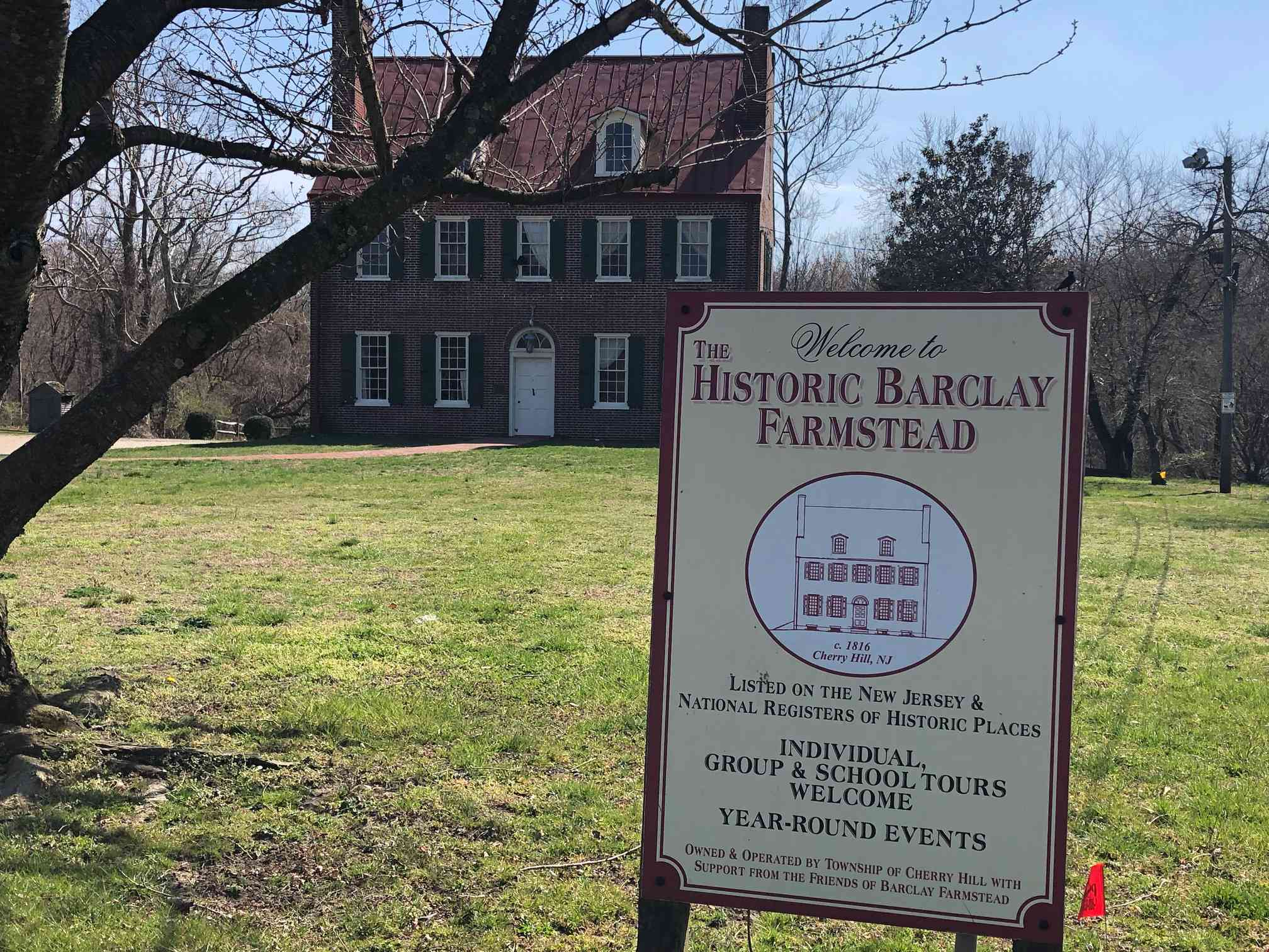 Outside Barclay Farm in Cherry Hill with sign