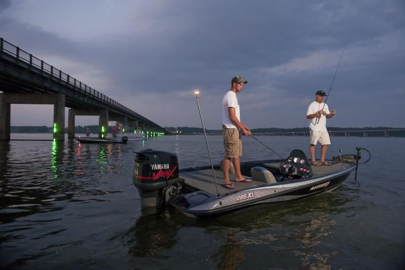 Men fishing off boat