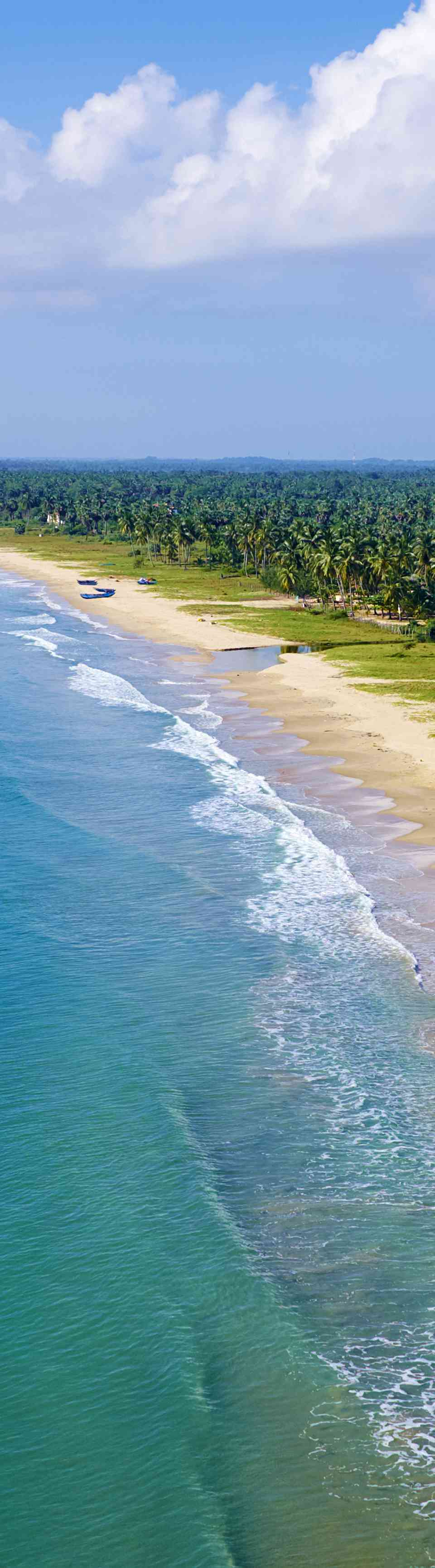 Blue water and an undeveloped beach in Sri Lanka