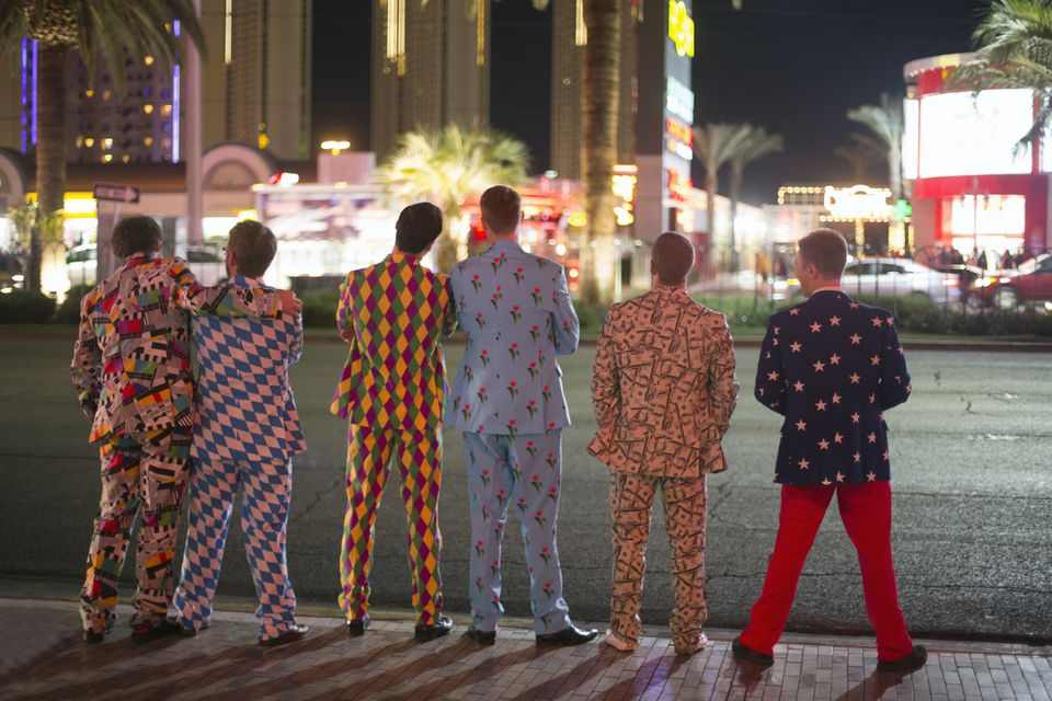 Men dressed in funny suits on the Strip