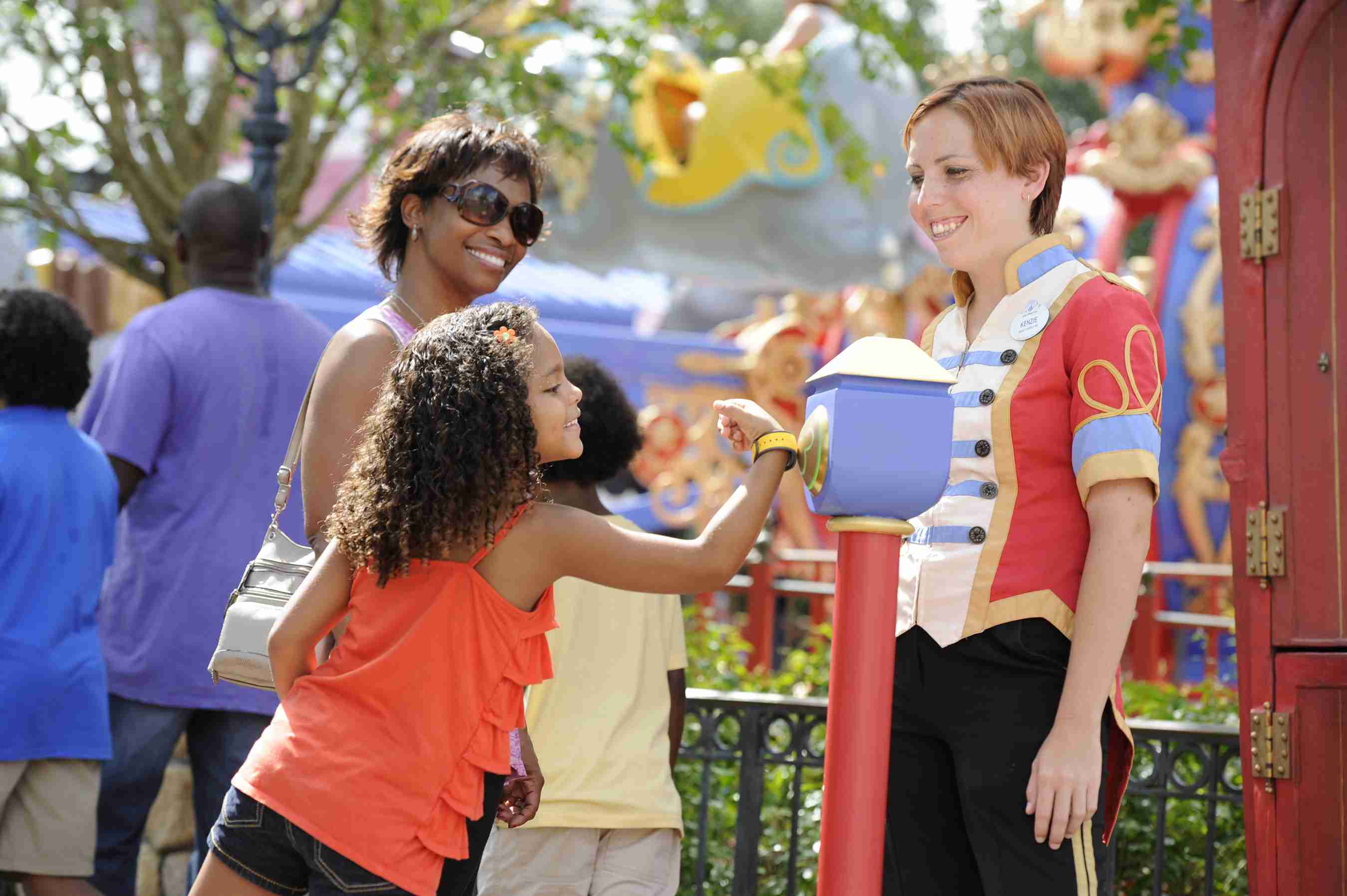 Guests using MagicBands to access rides