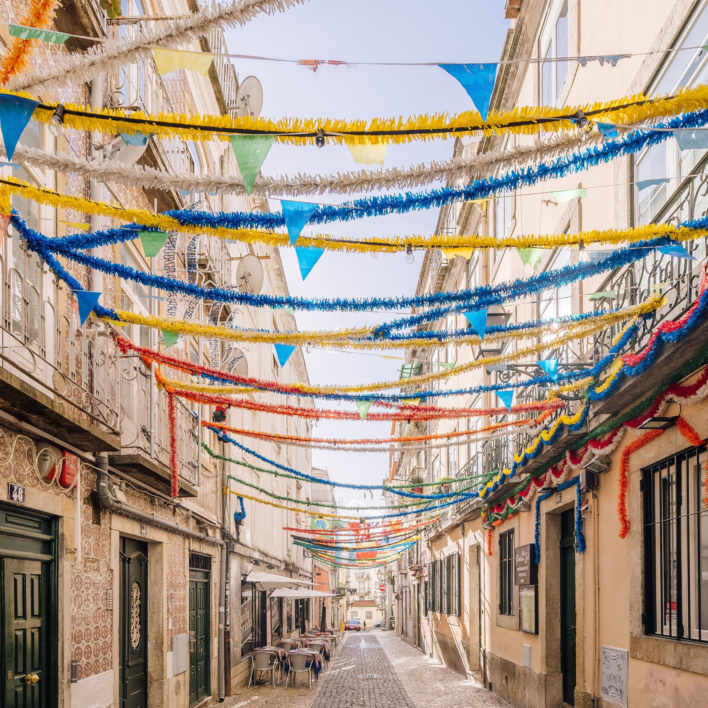 Alleyway in Bairro Alto covered in streamers