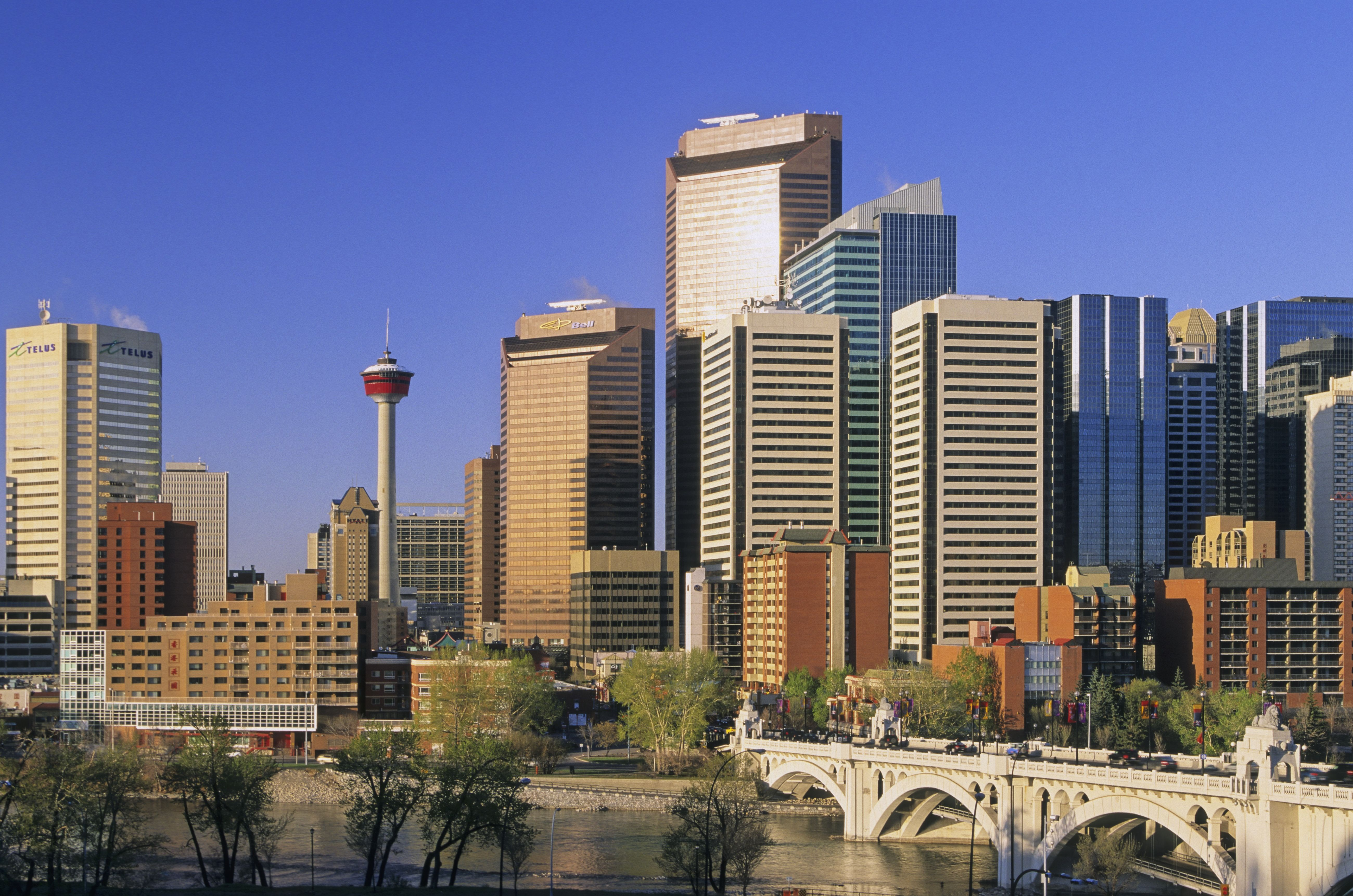 Canada, Alberta, Calgary city skyline across Bow River in day time