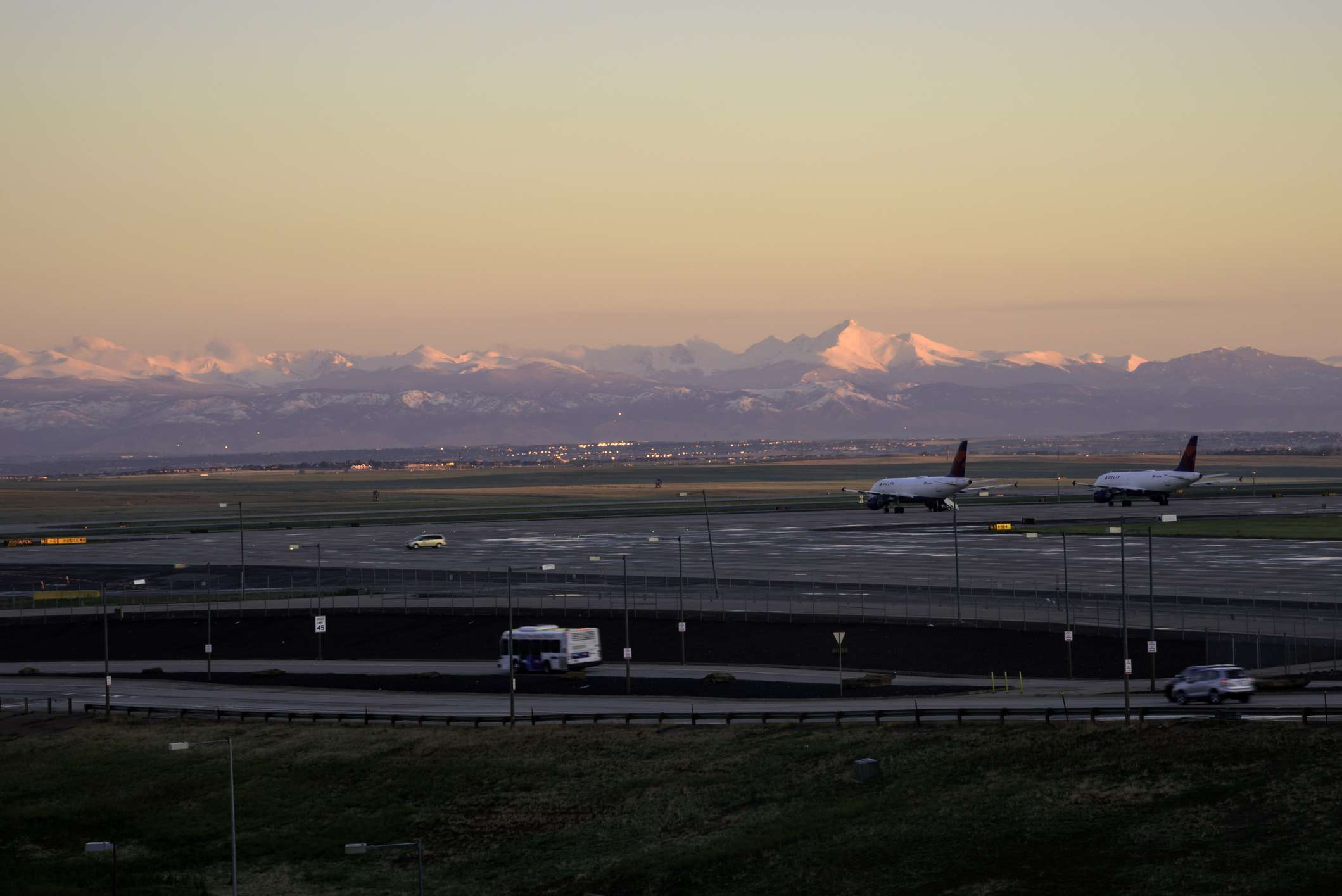 Denver International Airport at sunrise with the Rockies in the background