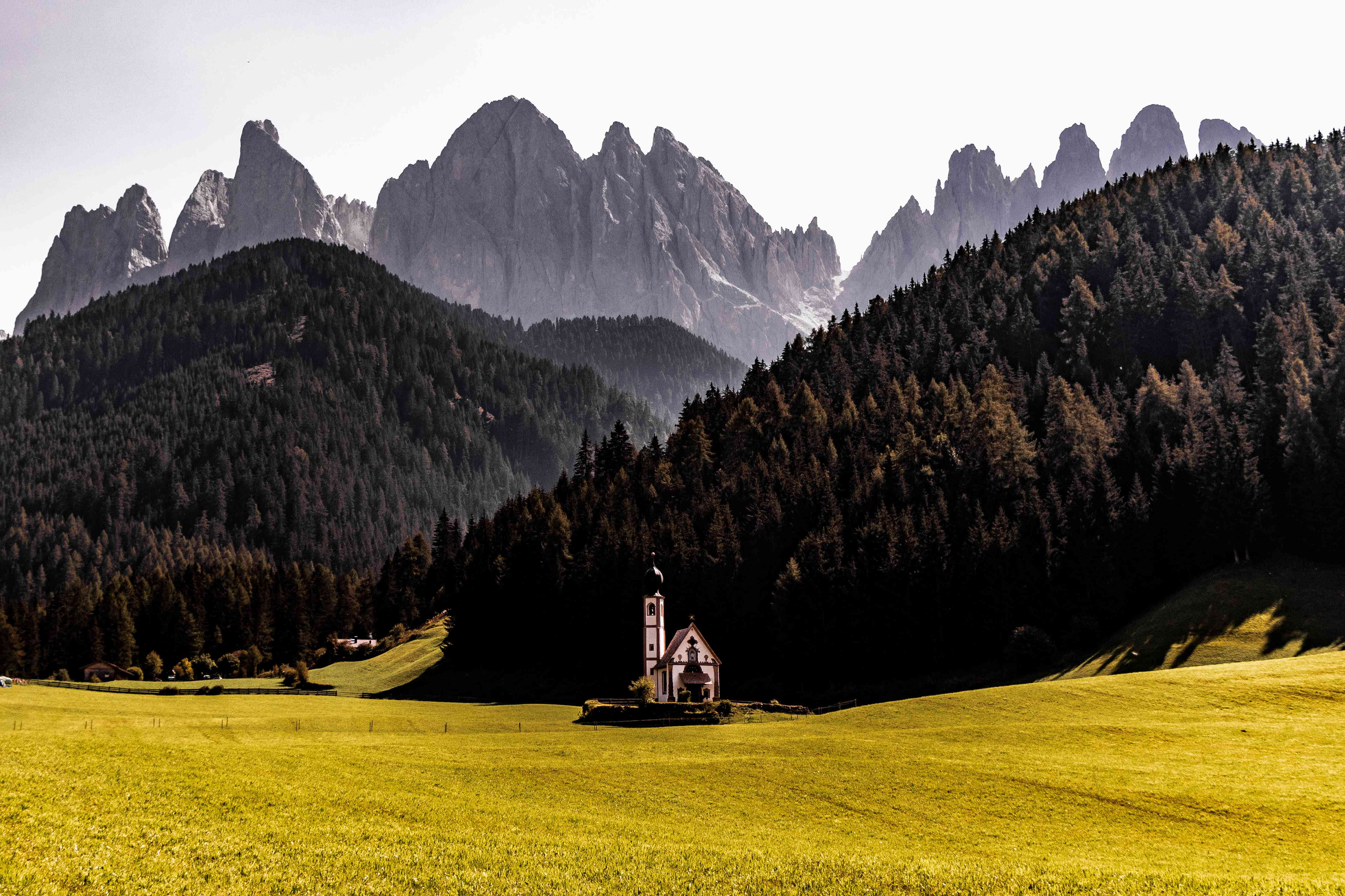 A small church in a valley in the Dolomites