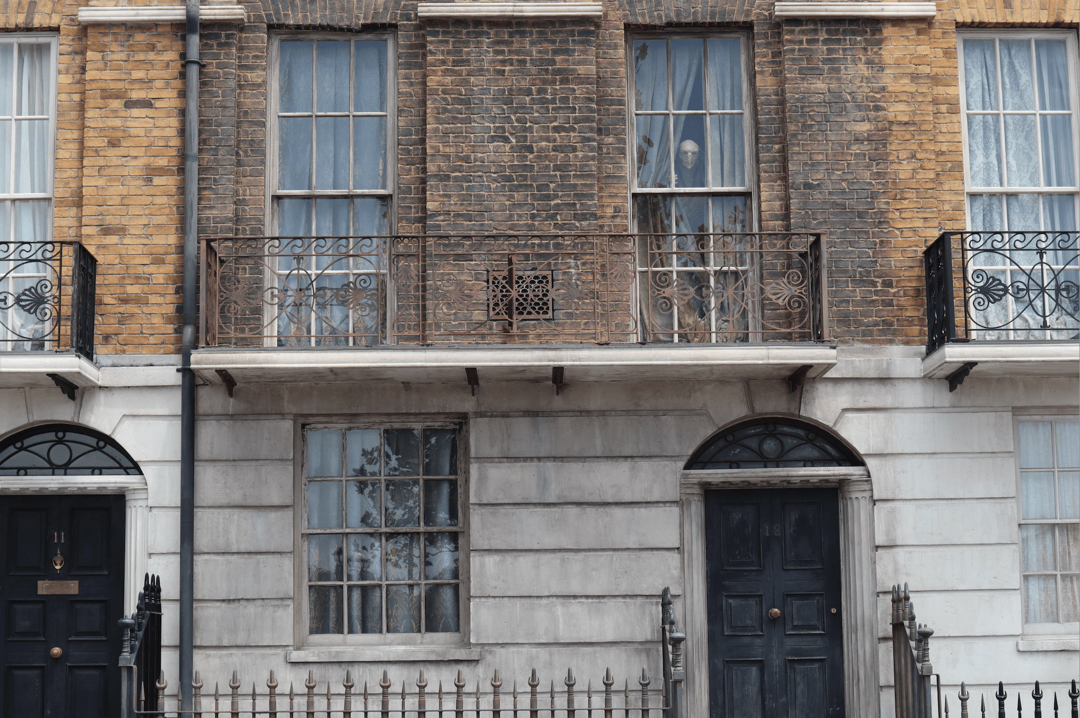 Replica of 12 Grimmauld Place with the house-elf Kreacher looking through a second floor window