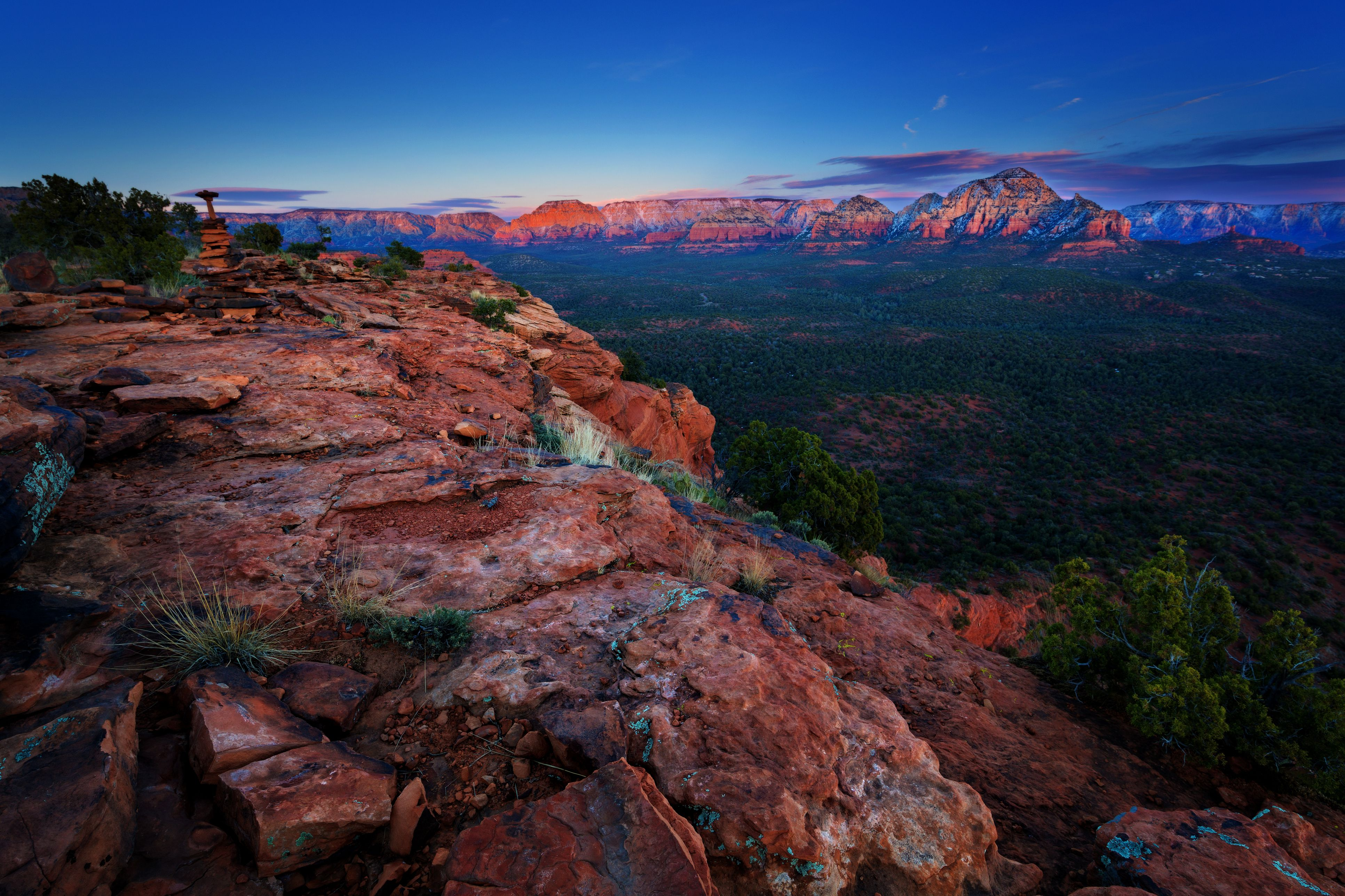 Dusk over Sedona Arizona rock formations dusted with snow viewed from summit of Doe Mountain in winter