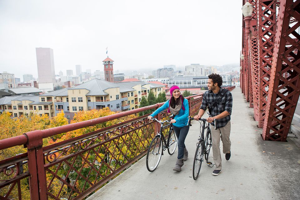 Couple walking on bridge with bikes