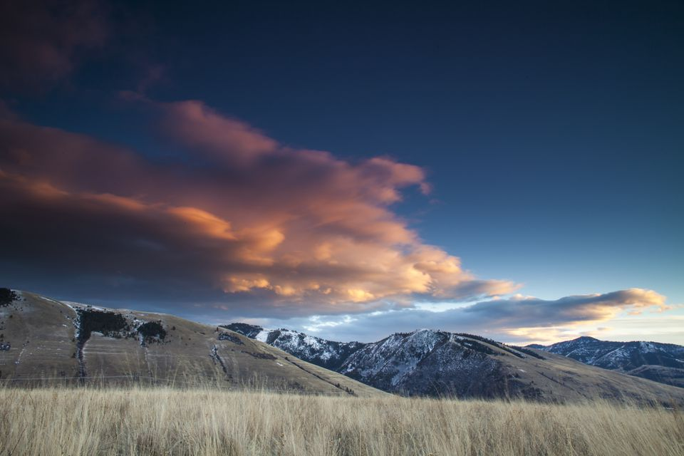 Clouds Glow pink over Mount Jumbo and Mount Sentinal near Missoula, Montana.