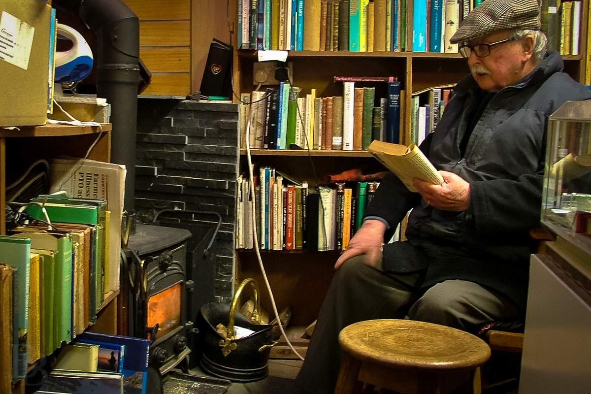 Michael Slavin in his bookstore at the Hill of Tara