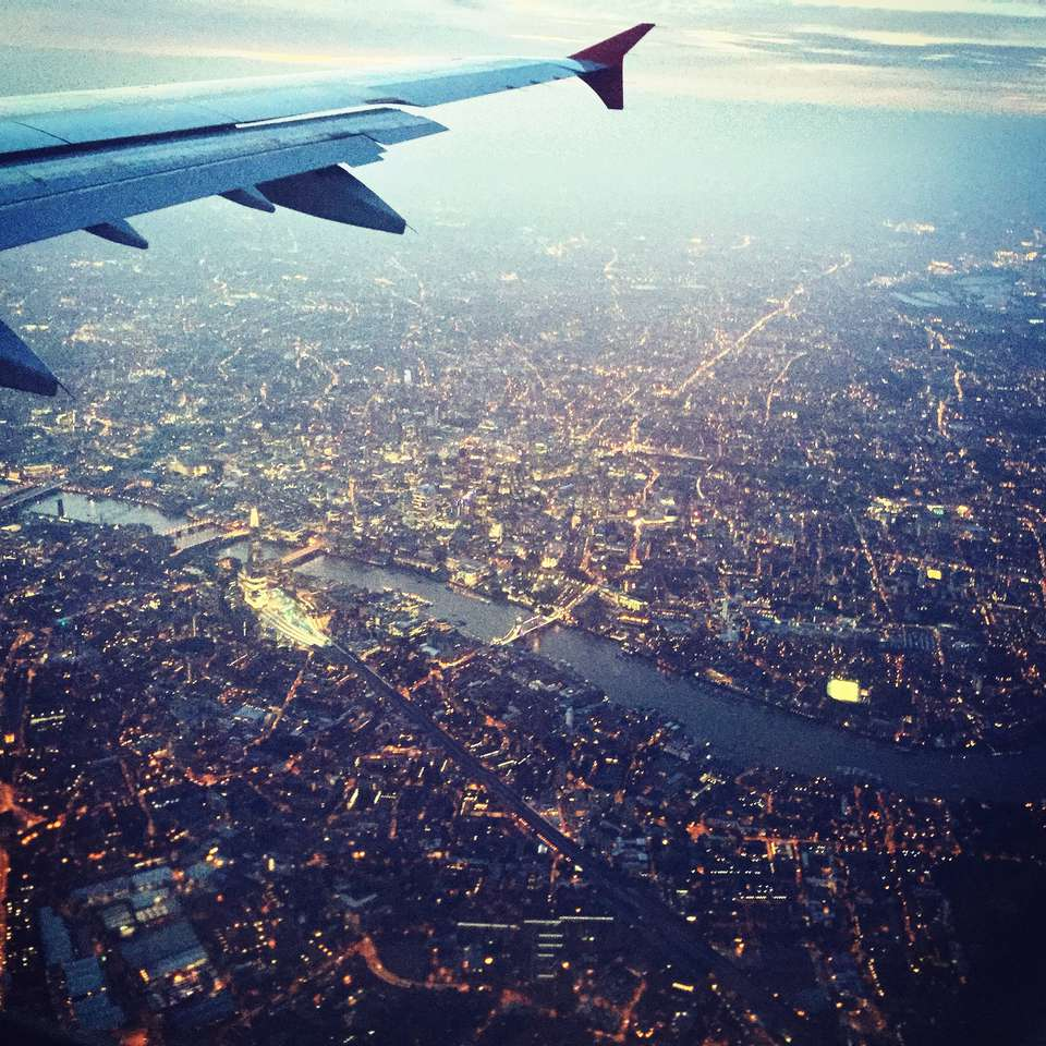 Aerial View Of Cityscape From Airplane Window