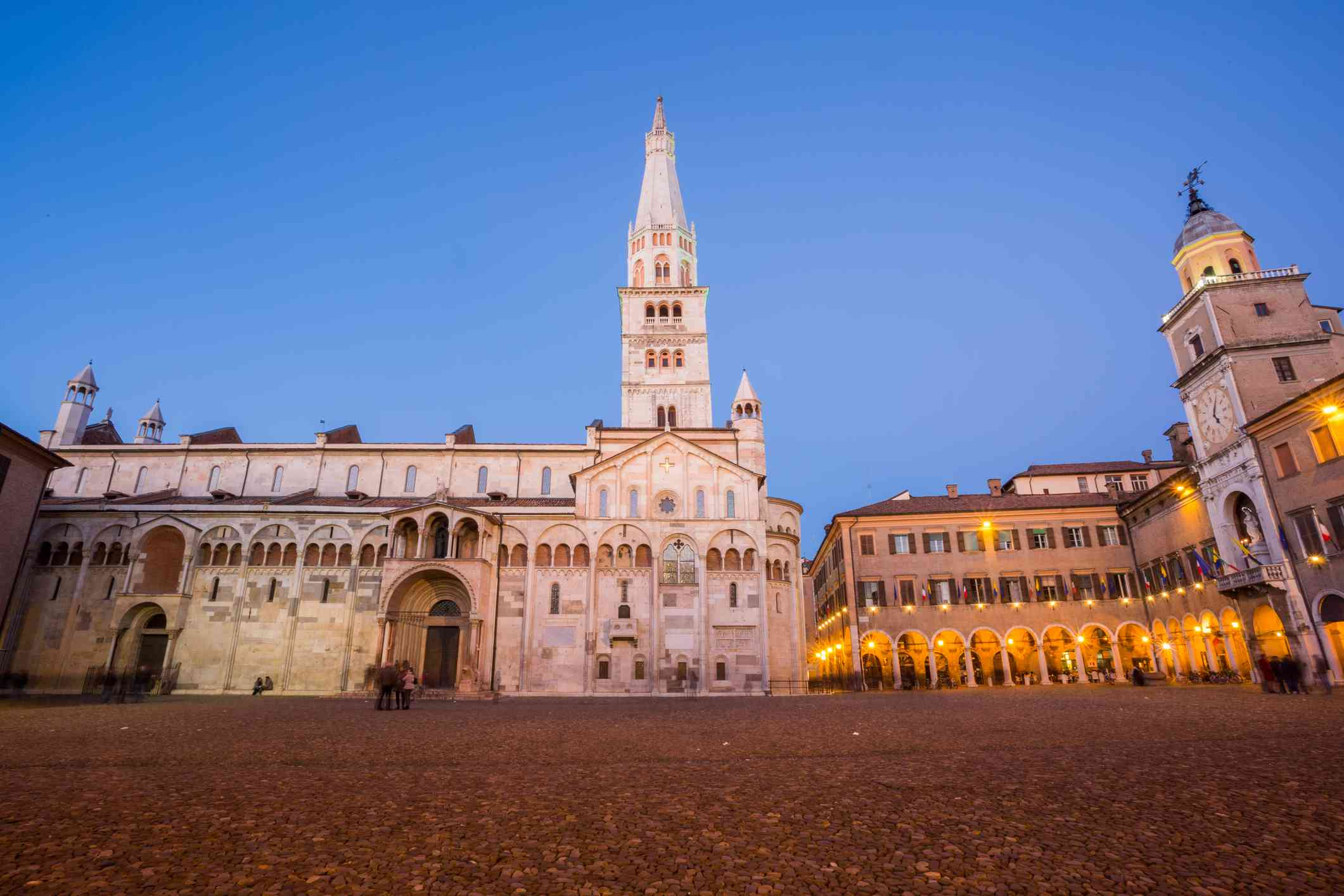 Modena, Emilia Romagna, Italy. Piazza Grande and Duomo Cathedral at sunset.
