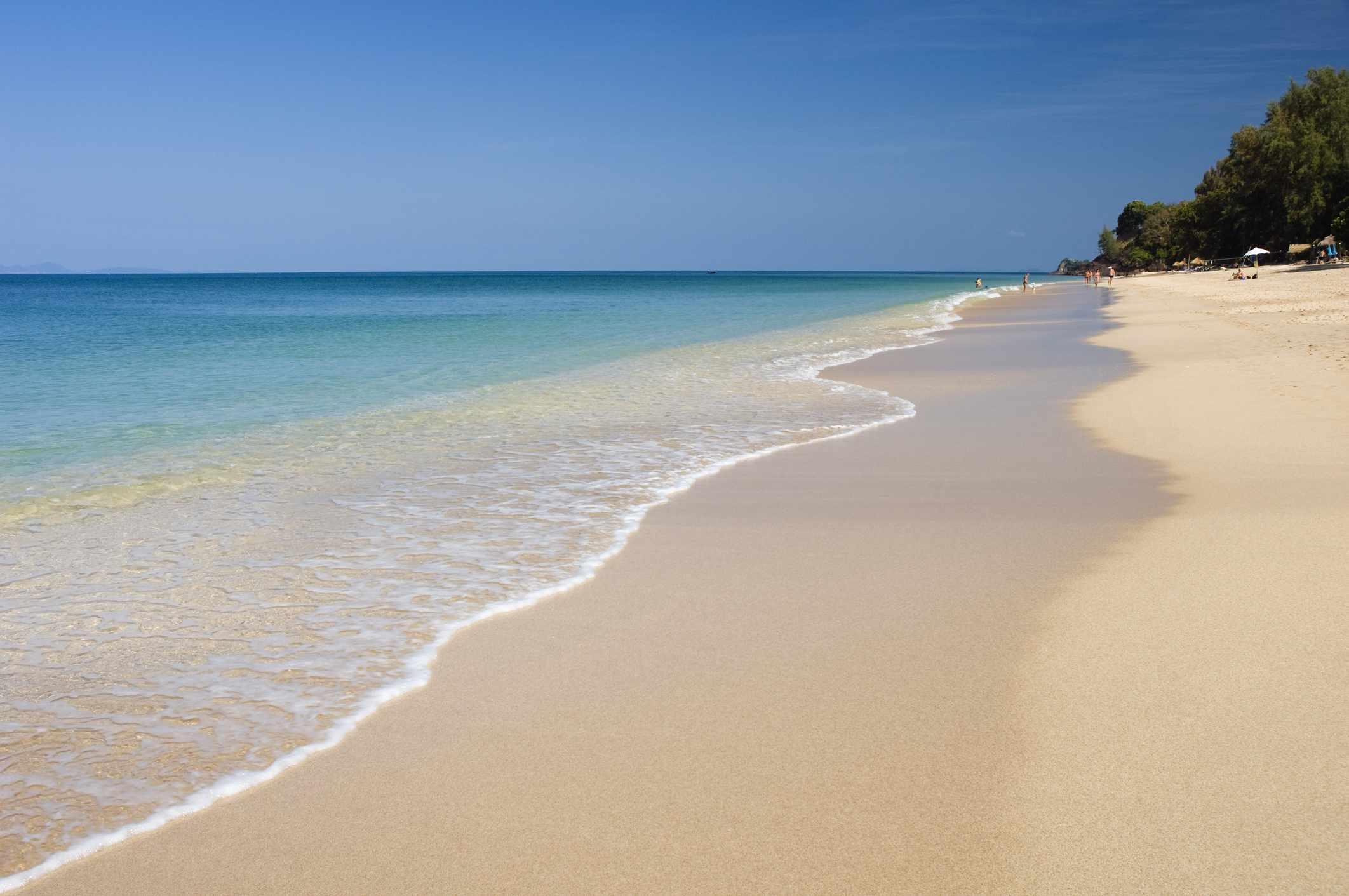 Pristine sand and gentle waves on Long Beach, Koh Lanta, Thailand