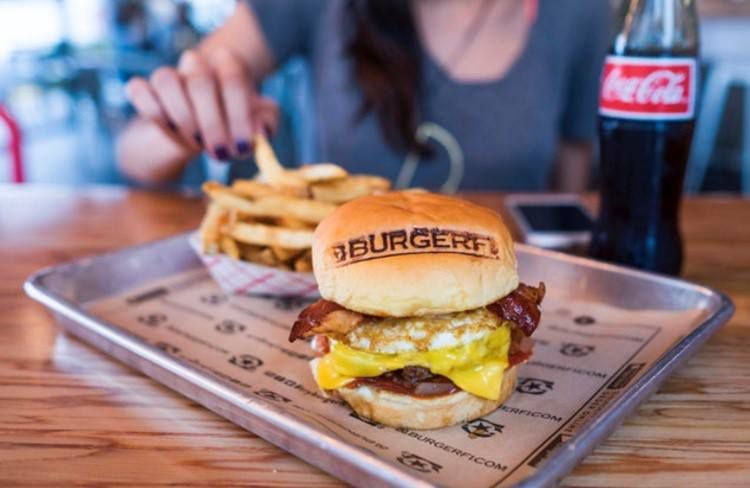 cheeseburger with a fried egg and bacon, stamped with