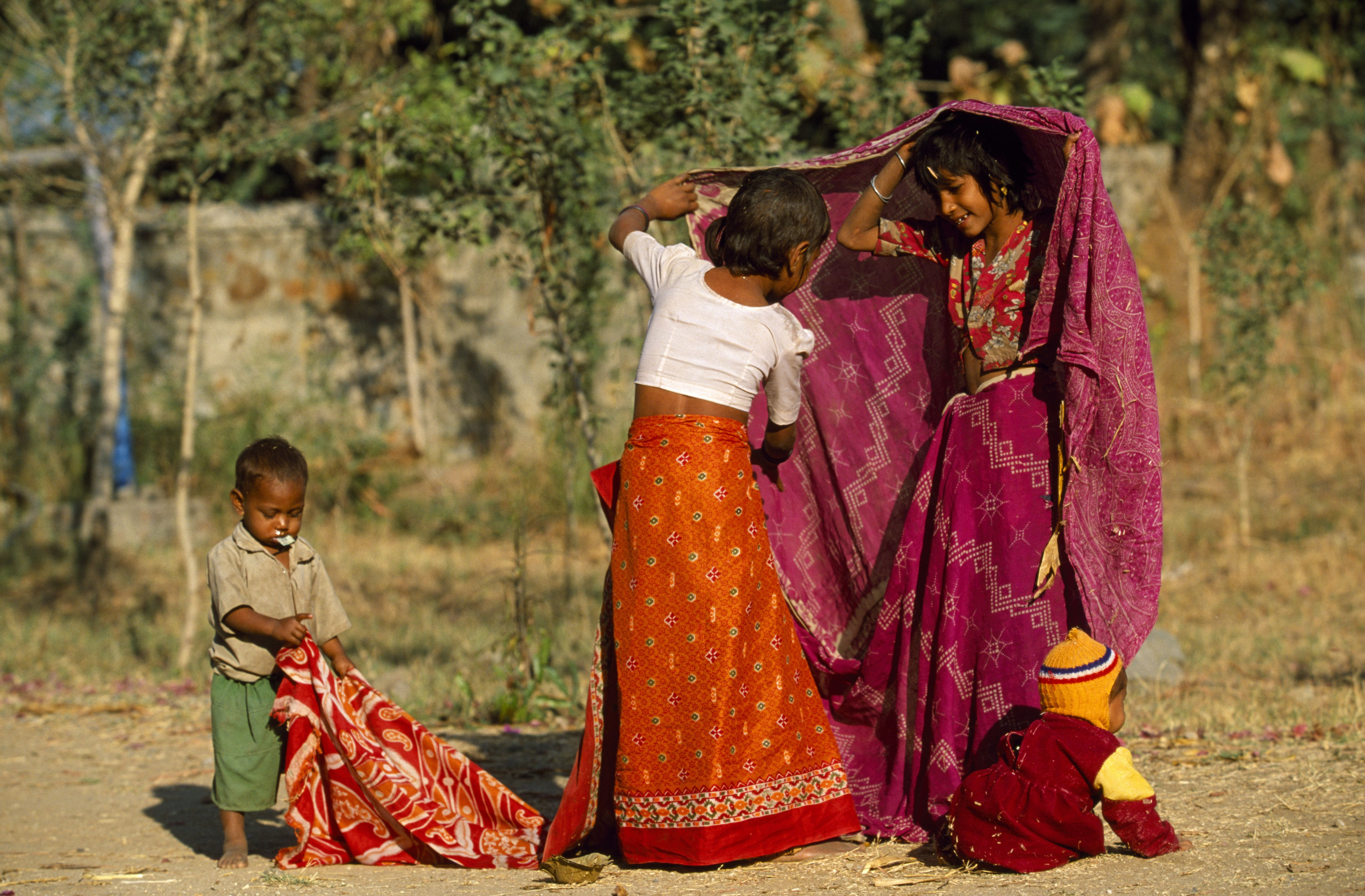 india rajasthan udaipur young rajasthani girls learning to tie saries near their rural home in kotra a village outside udaipur e223df78c d35c