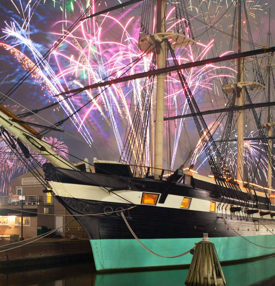 Fireworks behind the USS Constellation at Baltimore's Inner Harbor New Year's Celebration