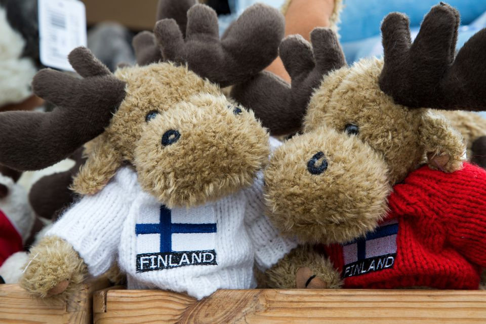 Stuffed elk toys with Finland sweaters for sale