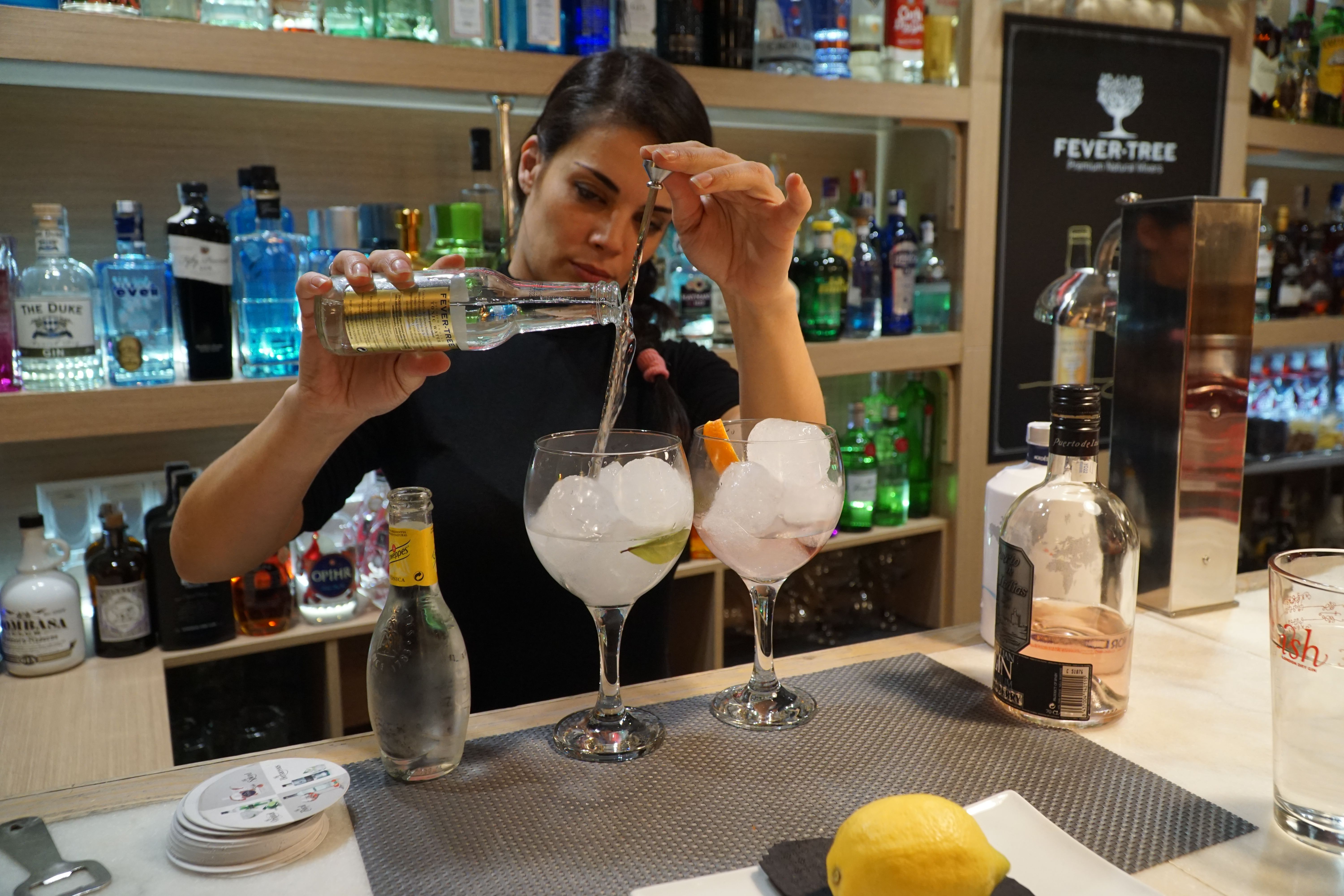 Pouring gin and tonics in Malaga