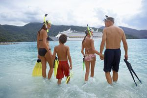 Parents with children (10-12) in water with snorkel gear
