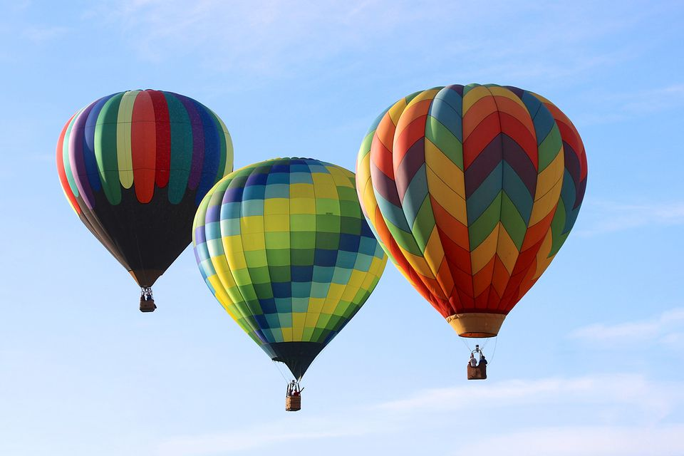 3 hot air balloons in the sky
