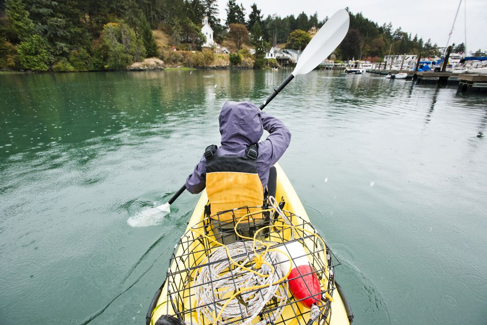 A girl kayaks through Roche Harbor, Washington.