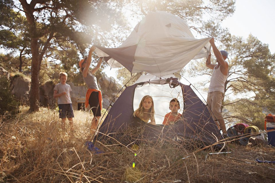 A family pitching a tent