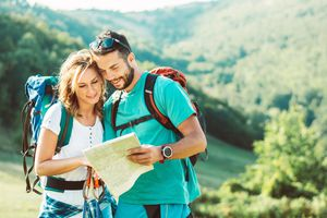 Hiking couple with map on mountain