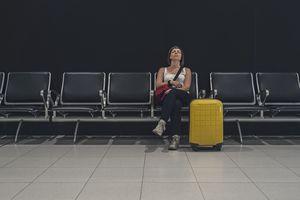 Woman sleeping in departure lounge