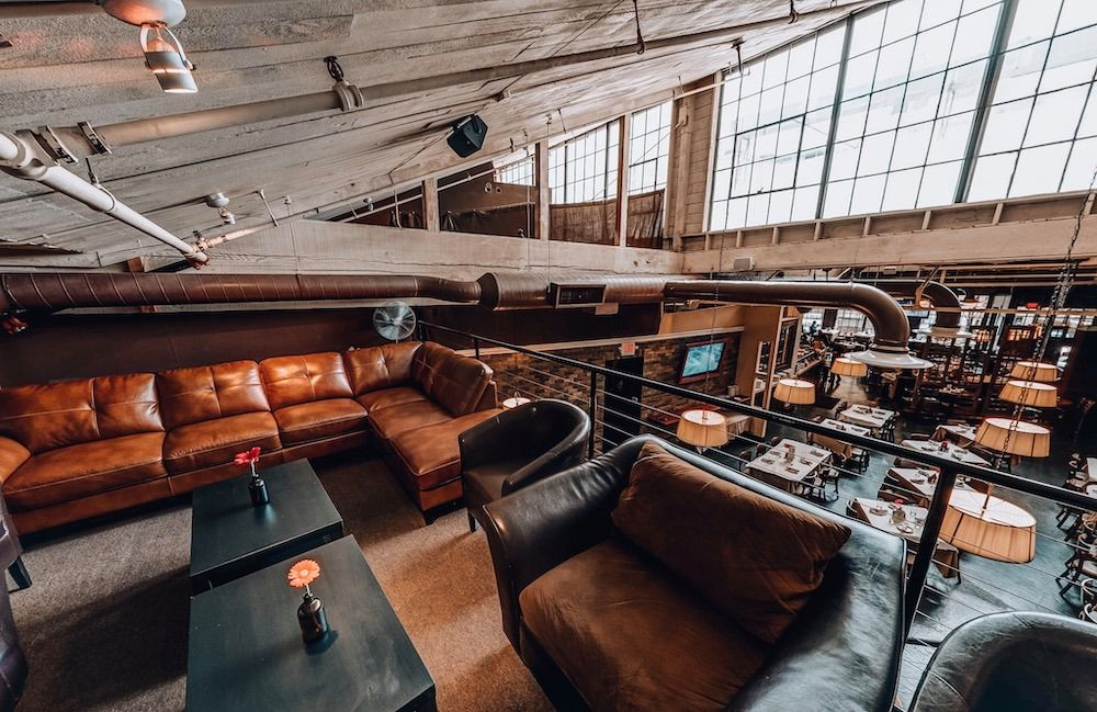 Brix Tavern interior with couches and indoor balcony