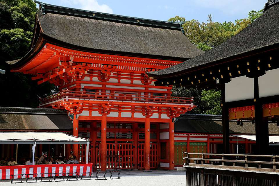 Red and white Shimogamo shrine with a black roof in Kyoto