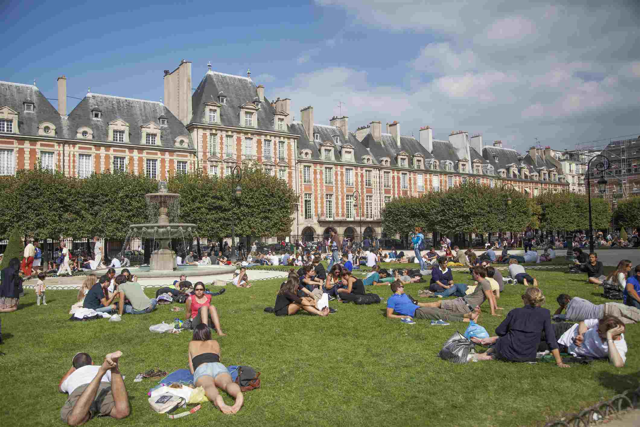The Place des Vosges is one of the best spots for a picnic on a sunny day in Paris.