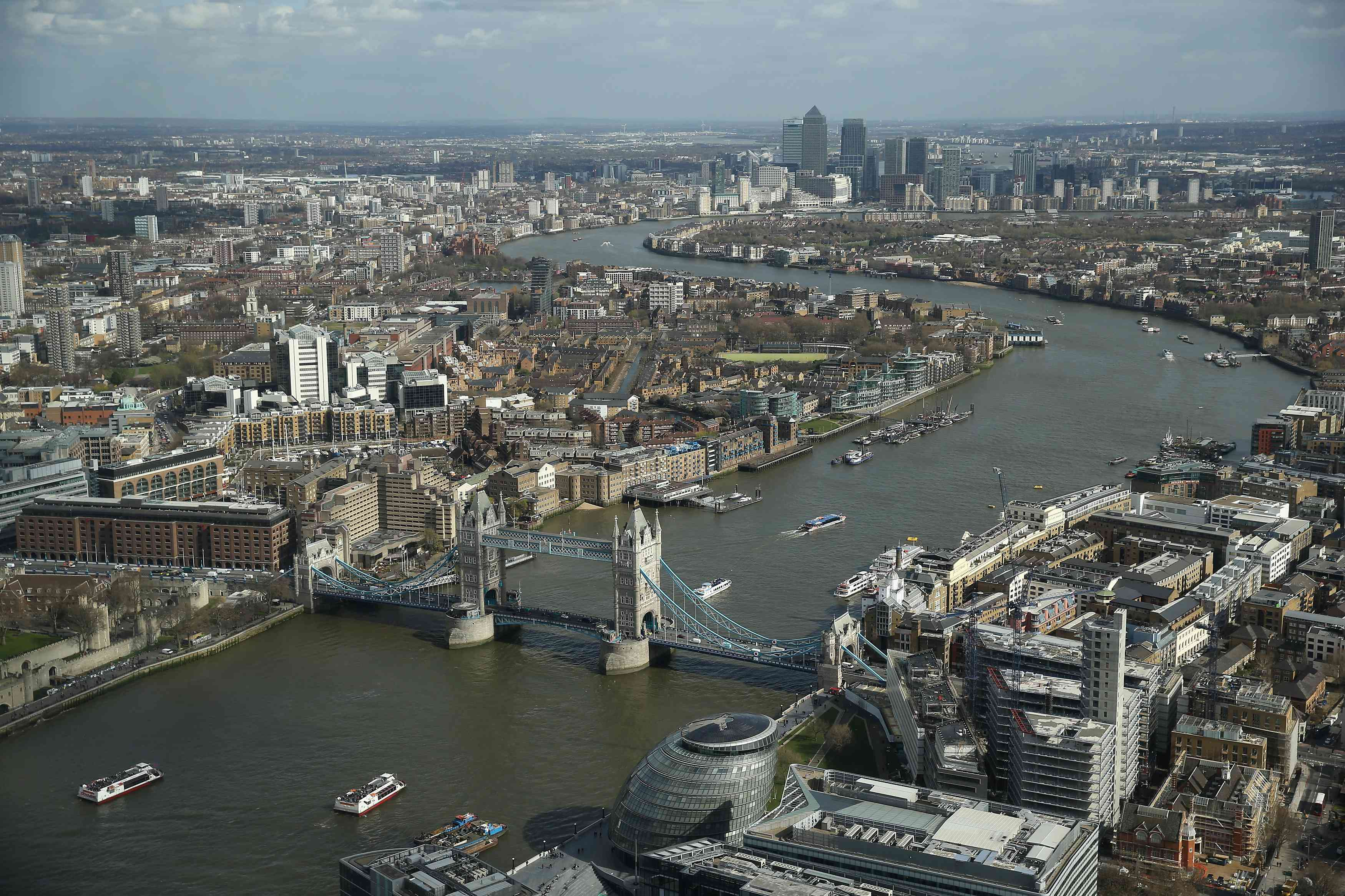 The Thames River snakes through the city center past Tower Bridge in this aerial view taken from the London Shard on March 21, 2014 in London, United Kingdom. The Shard is the city's tallest building and has become a major tourist attraction.
