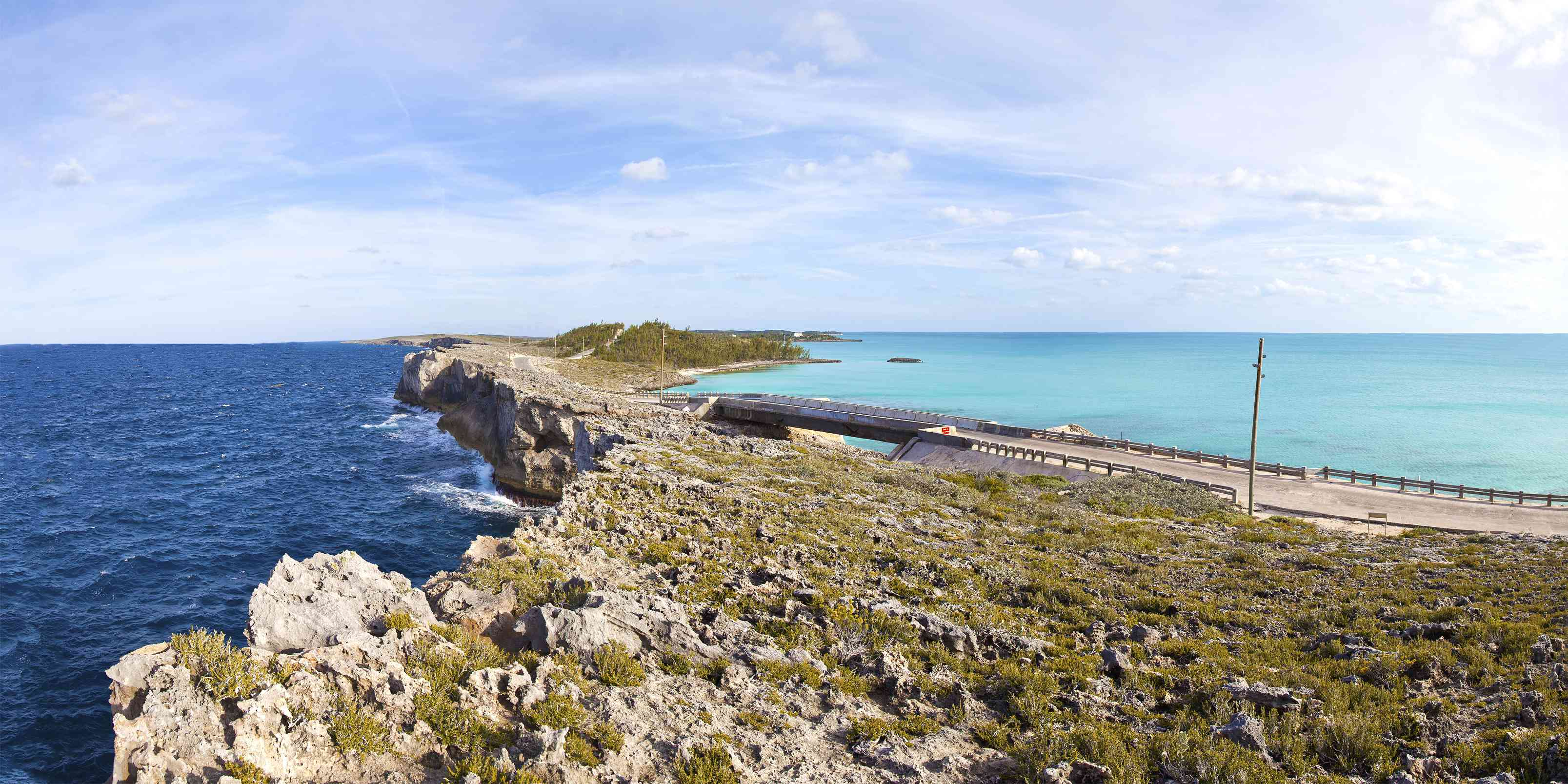 Glass Window Bridge at Eleuthera, Bahamas that separating the dark blue Atlantic ocean and the turquoise shallows