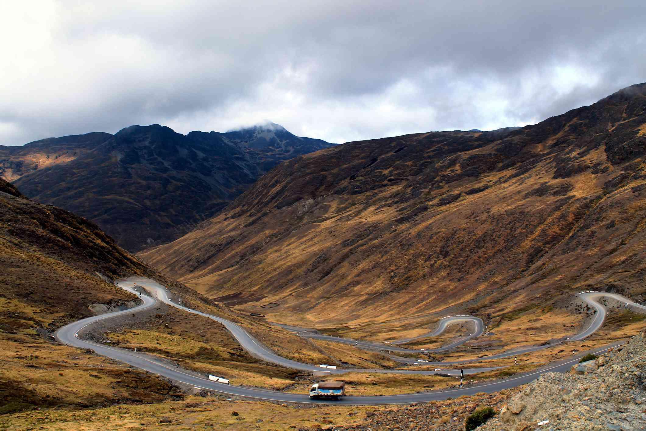 Truck on serpentine curvy road in Peru