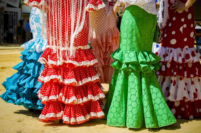 Women in flamenco dresses at a fair in Spain