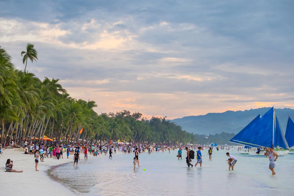 Crowds of people on White Beach at sunset, Boracay, Philippines