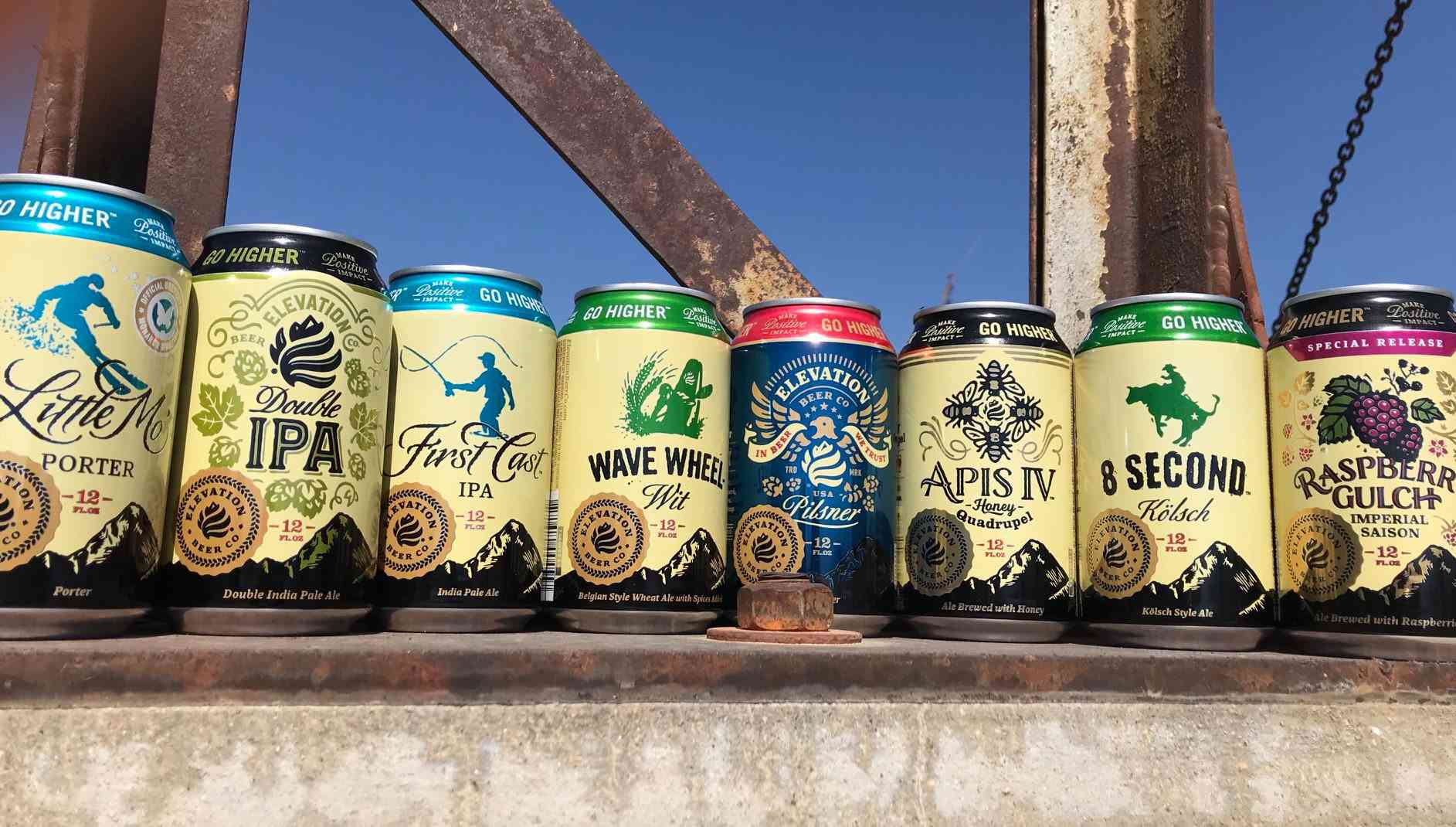 A line of different decorated beer cans