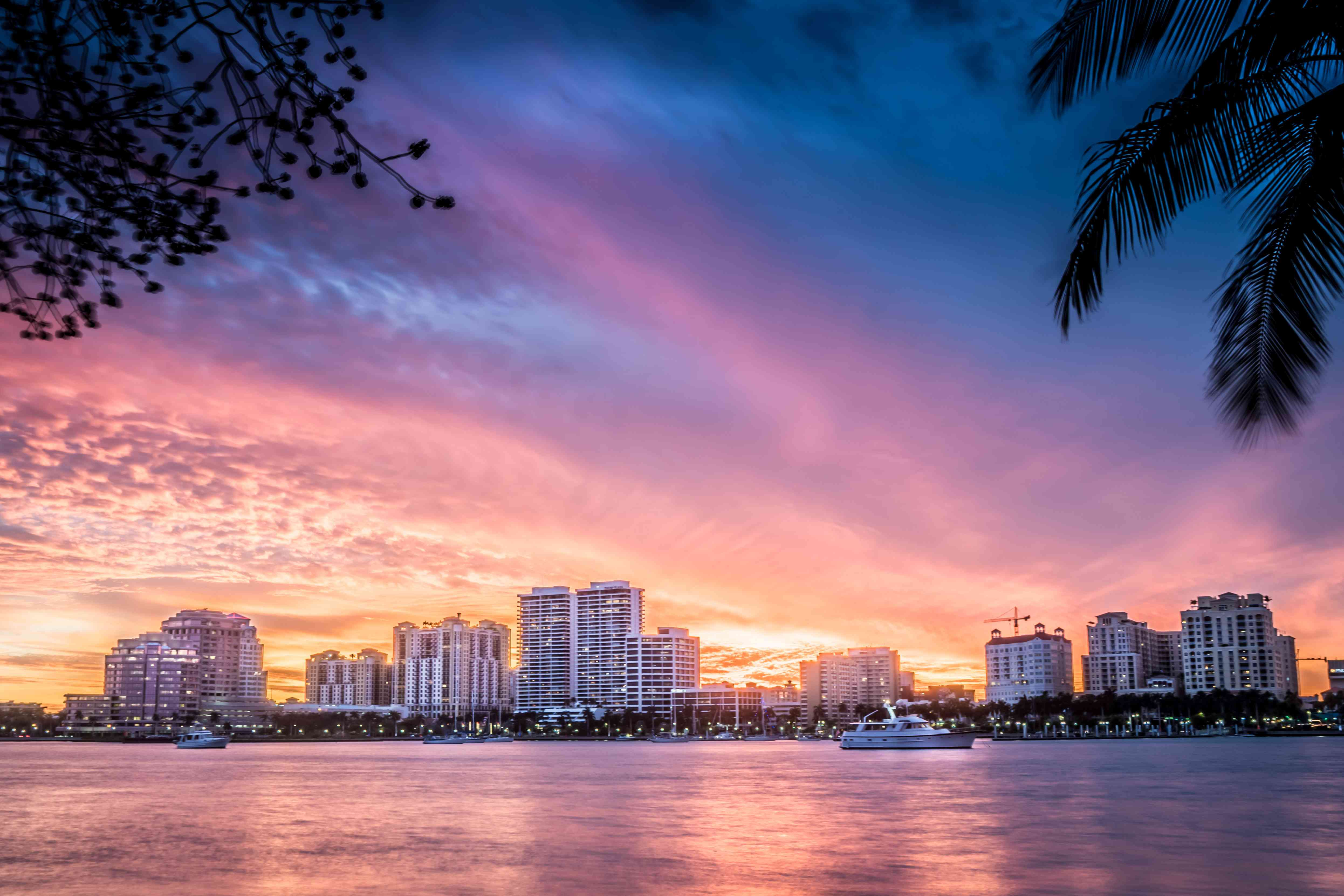 City At Waterfront During Sunset with pinkish skies reflected in the water